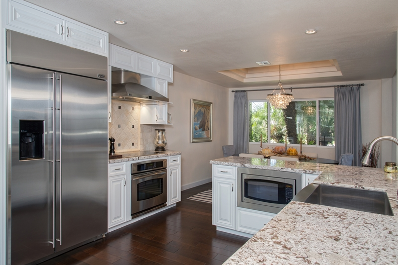 Scottsdale design-build remodeling of this kitchen with white cabinets and granite countertops