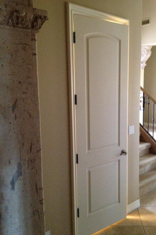 custom iron door on wine cellar remodeling design/build phoenix az