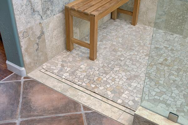 river rock tile floor in newly renovated bathroom