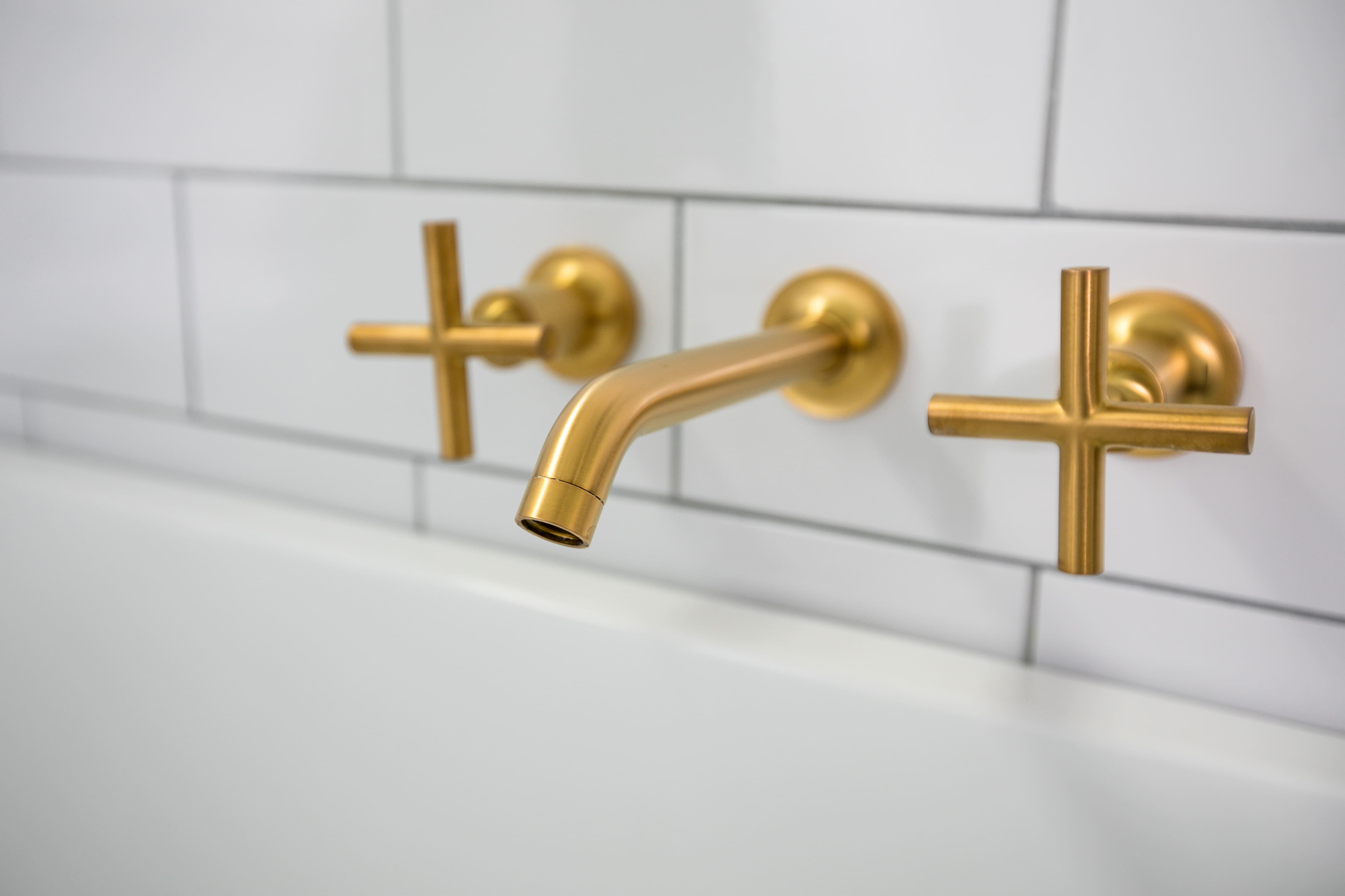 Gold bathroom fixtures by Tempe Remodeling Contractor